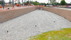 The completed retaining wall and drainage system installed at 225 Raritan Center Parkway in Edison, New Jersey.