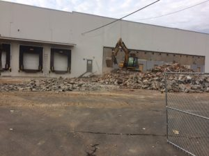 Concrete demolition and site preparation at Allen Flavors in South Plainfield, New Jersey.