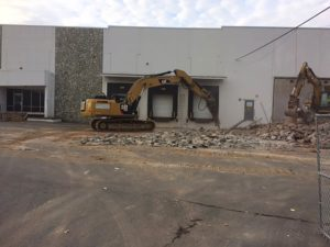 Concrete demolition with backhoes at Allen Flavors project in Plainfield, New Jersey.