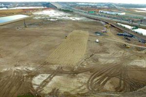 Land excavation and development with soil densification.