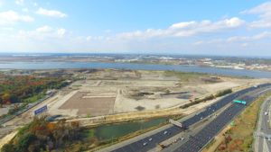 Aerial view looking towards the river of Bass Pro Shop project.