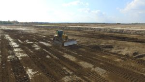 Bulldozer grading landing.