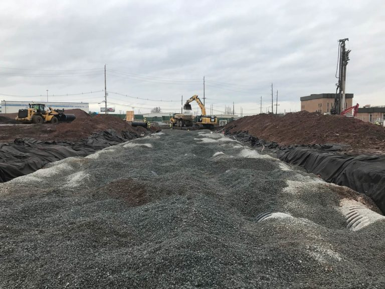 Losse gravel laid on top of plastic tiling at Centerpoint 49 Rutherford construction site.