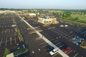 Aerial view of the completed Clark Commons parking lot and shopping center.