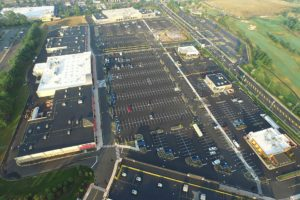An aerial view of the entire parking lot and shopping center at Clark Commons.