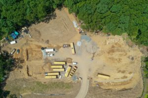 Overhead, aerial perspective of the construction site.