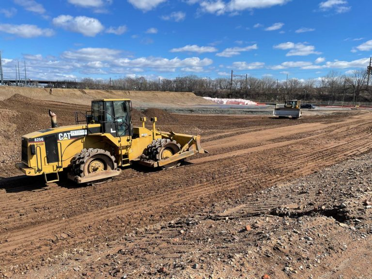Two bulldozers levelling land at the Hilco Hudson Project construction site.