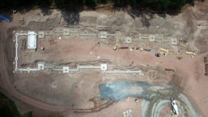 Overhead aerial perspective of completed concrete foundation construction.