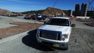 Petillo pick-up truck in parking lot being developed.