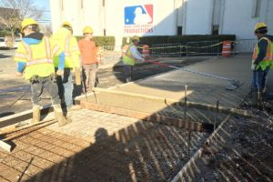 Concrete walkways poured and smoothed.