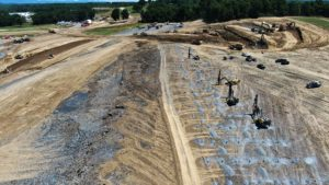Aerial view of blasting caps being set to loosen soil for excavation.