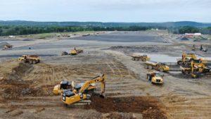 Site excavation with caterpillar heavy equipment vehicles