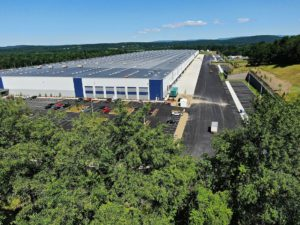 An aerial view of the Medline Warehouse and paved areas surrounding the new building.