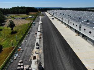 Aerial view of the truck loading bays at a logistics facility warehouse.