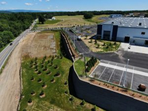 Driveway entrance, retaining walls, and water retention ponds at the newly built Medline Warehouse.