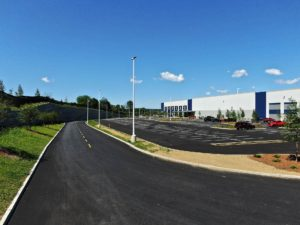 Paved driveways and parking lots finished by Petillo at the Medline Warehouse.