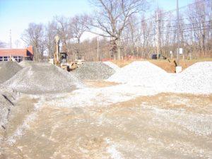 Piles of sub-base gravel ready for grading.