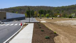 Completed sidewalk parking lot and landscaping at NYSCO in Hawthorne, New York.