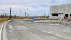 Asphalt and concrete construction completed at the Port E warehouse.