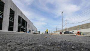 Close-up, ground-level perspective of asphalt paving.