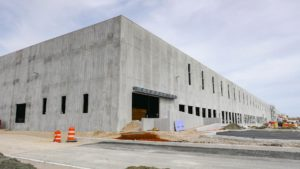 Exterior concrete work completed at the Port E warehouse.