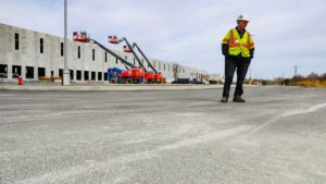 Project manager onsite inspecting work at Port E warehouse.