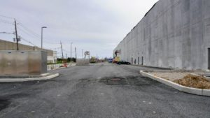 Exterior paving and curb work surrounding the Port E warehouse facility.