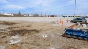 Parking lot cleared, levelled and prepared for paving.