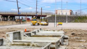 Site grading and levelling with bulldozers and rollers at Port E in Elizabeth, New Jersey.
