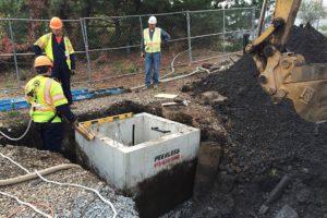 Precast concrete culvert being installed.
