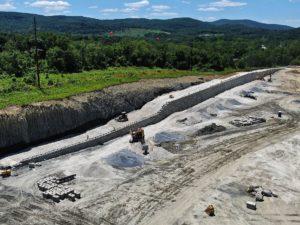 Retaining wall construction along an embankment.