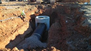 Precast concrete water culvert set into place and connected to tiling.