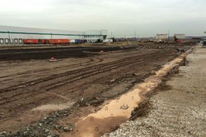 Land cleared and levelled in preparation of warehouse foundation construction.