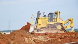 A bulldozer grading earth at the Rockefeller project in Piscataway, New Jersey.