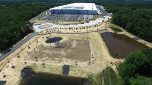 Aerial view of the completed Sailfish warehouse, parking lots, water management ponds, and driveways.
