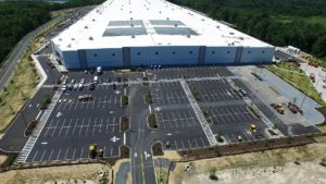 Sailfish warehouse aerial view of newly paved and painted parking lots for employees.