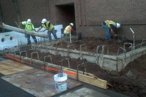 Pouring concrete foundation walls.
