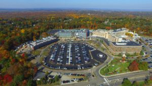Aerial view of the parking areas and hospital extension at St. Barnabas Medical Center.