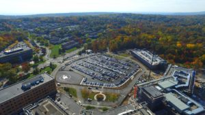 Aerial view of the completed parking lot, parking garage, and hospital extension at St Barnabas Medical Center.