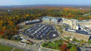Alternate aerial view of the completed parking lot, parking garage, and hospital extension at St Barnabas Medical Center.