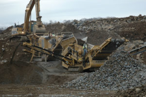 Excavator loading crusher.