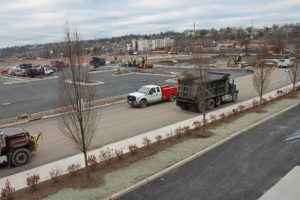 Alternate angle of dump trucks hauling fill.