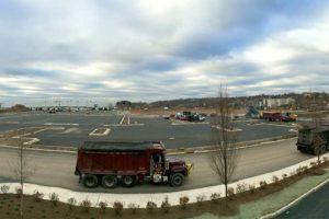 Dump trucks hauling fill.