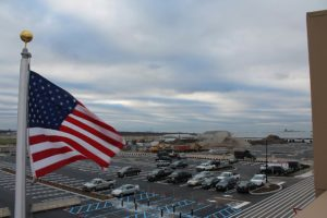 American flag overlooking the completed parking lot at Teterboro Landings.