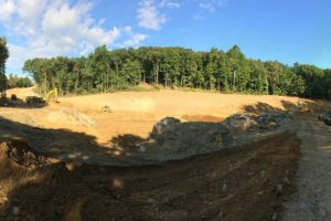 A bulldozer clearing and grading the land at the Loops in Newburgh, New York.