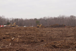 Clearing and grading land.