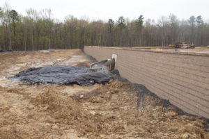 Retaining wall with drainage culvert installed.