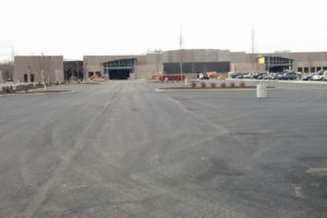 Paved parking lot and view of the new Walmart under construction.