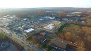 Western aerial perspective of the Hanover Crossroads shopping mall construction.