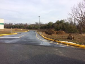 Paved entrance with curbs for Interstate Boulevard Phase 1 project.